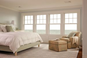 luxury master bedroom with water view